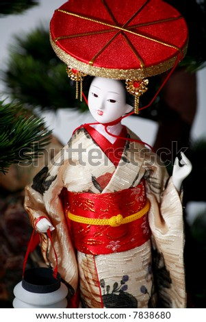 Japanese geisha doll on the white  background - stock photo