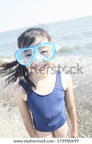 Japanese Girl wearing water glasses in the water