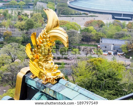 Japanese golden killing whale image decorated at the roof of Osaka castle, Osaka, Japan - stock photo