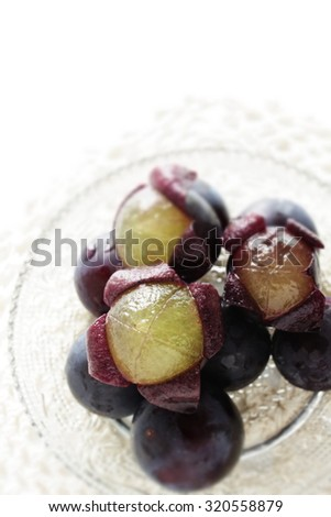 Japanese grape, Kyoho autumn fruit on glass dish in diorama style