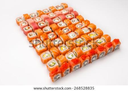 Japanese great sushi & roll set on a white background - stock photo