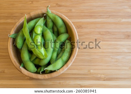 Japanese green soybeans on the wooden table. - stock photo
