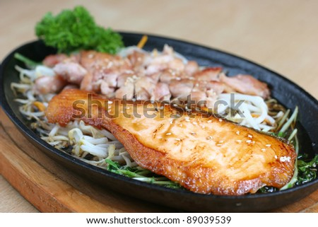Japanese grilled chicken and fish in terriyaki sauce - stock photo