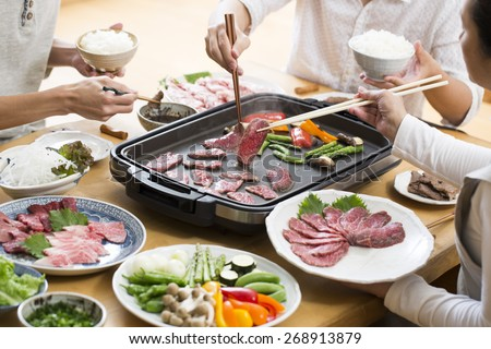 Japanese home cooking, eating grilled meat - stock photo