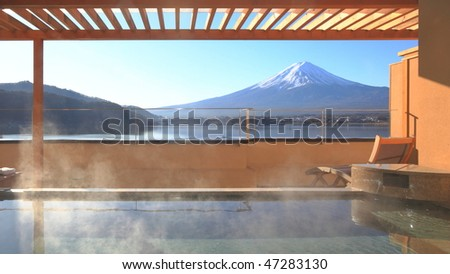 Japanese hot spring with view of the mountain Fuji - stock photo