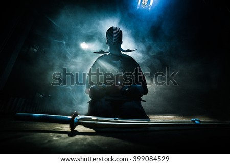 """Japanese Kendo fighter is preparing to fight.  (Inscription on the Japanese """"Shogun"""") - stock photo"""