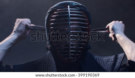 Japanese Kendo. Kendo fighter wears a helmet. - stock photo