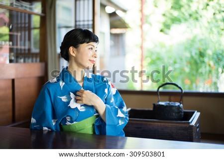 Japanese kimono woman in Japanese style room - stock photo