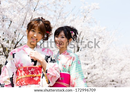 japanese kimono women and cherry blossom - stock photo