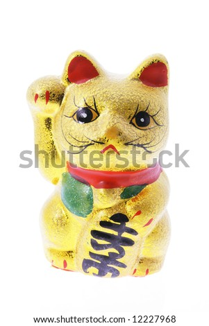 Japanese Lucky Cat Figurine on white Background - stock photo