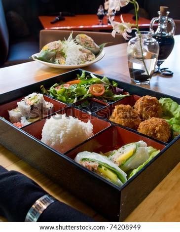 Japanese lunch bento box with fried scallops - stock photo