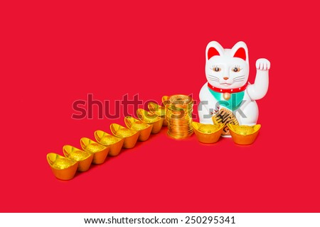 Japanese Maneki Neko, called Chinese lucky cat, popular among Chinese merchants, with Chinese money, stacked Chinese copper coins and gold ingots, Concept of wealthy, prosperous, business successful. - stock photo