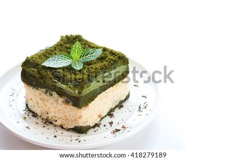 Japanese Matcha Green tea cake on white plate - stock photo