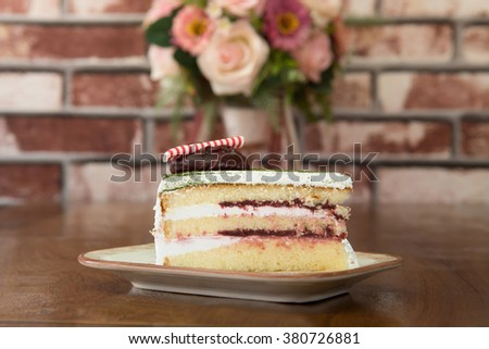 Japanese Matcha Green tea cake with red bean jam topping - stock photo