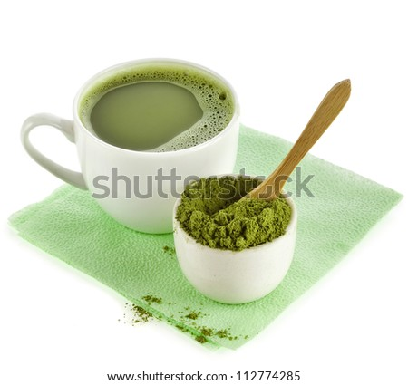 Japanese Matcha green tea in cup and tea powder isolated on white - stock photo