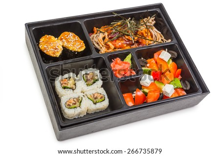 "Japanese Meal in a Box (Bento) isolated on white background - salad ""Greek"", Soba noodles with vegetables and chicken in chili sauce, baked snapper sushi, roll with salmon in tempura with salad - stock photo"