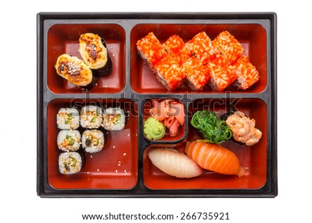 Japanese Meal in a Box (Bento) with seafood, sushi and rolls isolated on white background