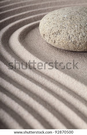 Japanese meditation spa garden pattern of sand and stones with curved lines for balance and relaxation zen buddhism - stock photo