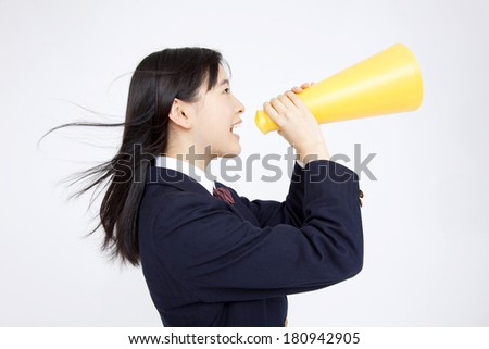 Japanese Middle school girl screaming through a megaphone