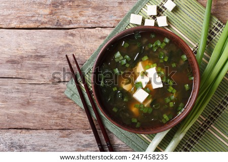 Japanese miso soup in a brown bowl on the table. horizontal view from above  - stock photo