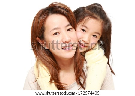 Japanese mother giving her daughter piggy back