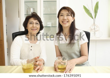 Japanese mother -in-law and daughter-in-law with a smile - stock photo