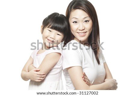 Japanese mother with daughter family portrait shot against white studio background