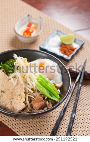 Japanese noodle  with Thai spicy soup, pork and onsen egg.