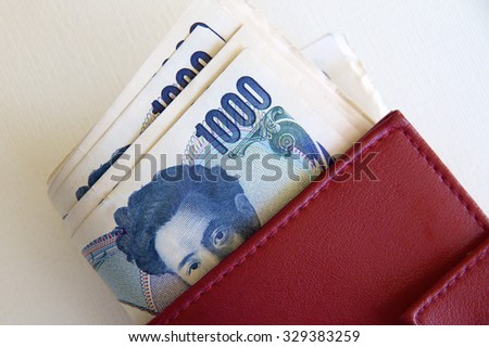 Japanese Notes in a Red Purse