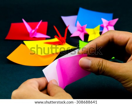 Japanese Origami Toys Folding Instructions; How to Play - stock photo