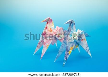 Japanese paper origami horses - stock photo