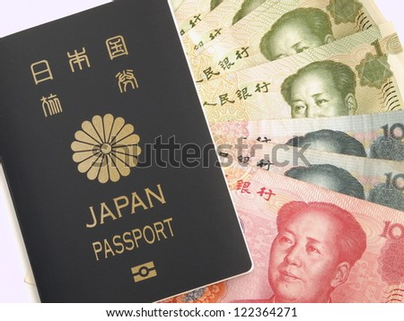 Japanese Passport and Chinese Yuan Note - stock photo