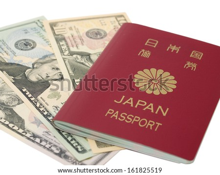 Japanese passport and US dollar notes - stock photo