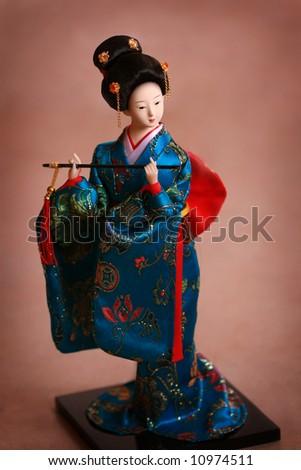 Japanese porcelain doll  kimono - stock photo