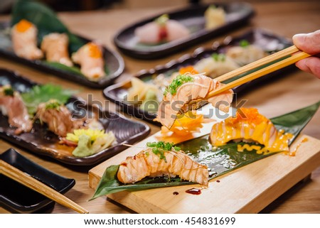 Japanese premium salmon sushi burn  on wood table.