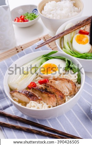 Japanese ramen soup with chicken, egg and pak choi cabbage on wh