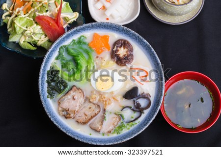 japanese ramen with mushroom,eggs,and sea food, and pork meat - stock photo