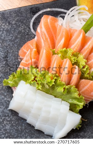 Japanese raw fish or sashimi served on a plate - stock photo