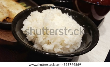 japanese rice in black round bowl - stock photo