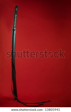 japanese sabre on red background - stock photo