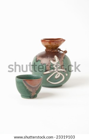 Japanese Sake cup and pitcher isolated on white.