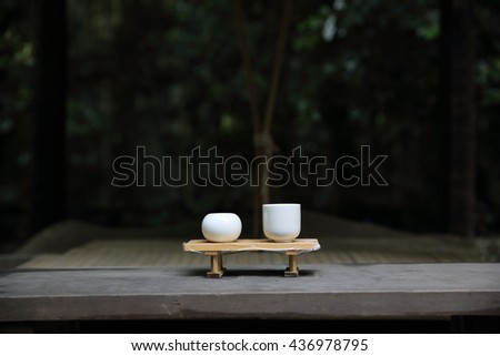 japanese sake on wood in forest Japanese temple - stock photo