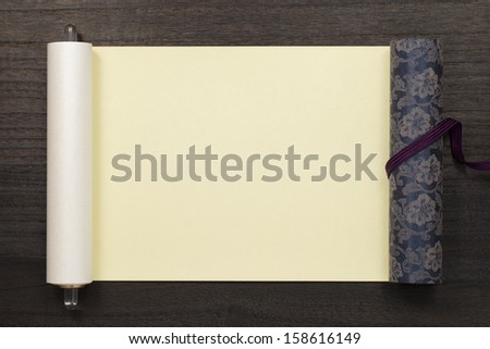 japanese scroll on dark wooden background - stock photo