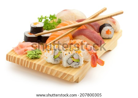 japanese seafood sushi and chopsticks on wooden plate - stock photo