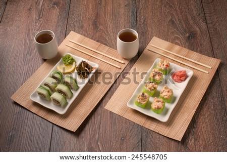 Japanese seafood vegetarian sushi set on white plate - stock photo
