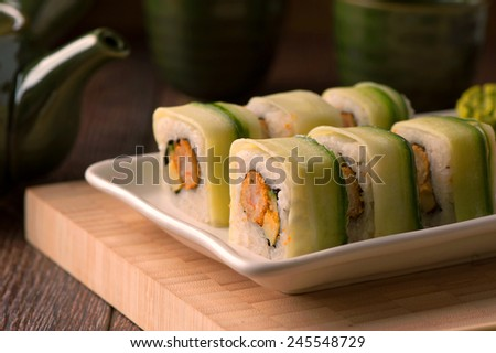 Japanese seafood vegetarian sushi set on white plate - stock photo