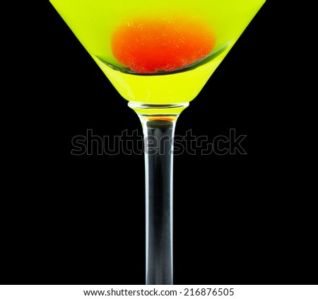 Japanese Slipper is a cocktail that contains melon liqueur, triple sec, freshly squeezed lemon juice and is garnished with a maraschino cherry - stock photo