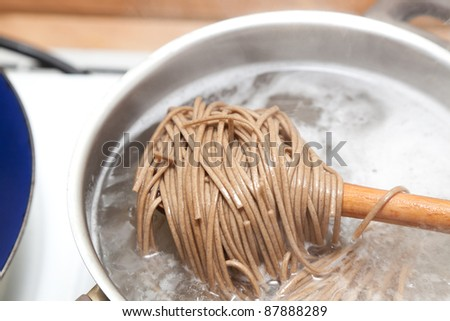 Japanese soba noodles cooking - stock photo