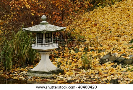 Japanese stone lamp in autumn