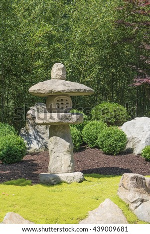 Japanese stone lamp in the Japanese garden. Vertically.  - stock photo